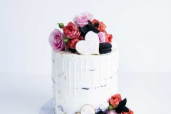 4. Custom Cookie Drip Cake with Florals